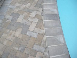 New Tile & Coping with Patio Stone Deck