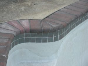 New Patio Stone Coping with Concrete Deck