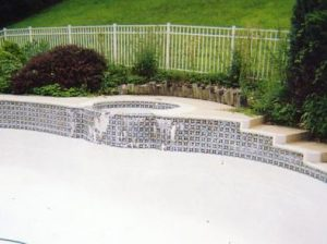 New Tile, Coping and Caulking with a Raised Spa Wall.
